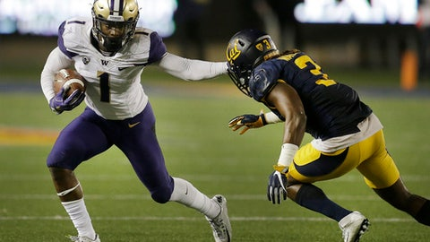 FILe - This Nov. 5, 2016, file photo shows Washington's John Ross, left, running against California's Cameron Walker during the second half of an NCAA college football game in Berkeley, Calif. Sure, Ross is a bit undersized, but he will be the fastest player on just about any field on which he steps. Receivers with legit 4.2 speed and reliable hands get drafted in the first round.  (AP Photo/Ben Margot, File)