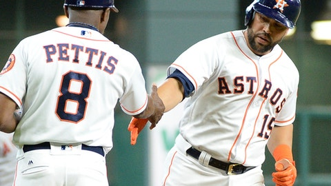 Houston Astros' Carlos Beltran (15) is congratulated by third base coach Gary Pettis after hitting a solo home run against the Los Angeles Angels in the first inning of a baseball game Thursday, April 20, 2017, in Houston. (AP Photo/George Bridges)