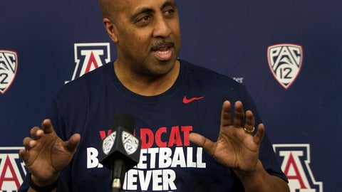 Lorenzo Romar answers questions during an NCAA college basketball press conference, Thursday, April 20, 2017, at the University of Arizona in Tucson, Ariz. Romar, the former head men's basketball coach at the University of Washington, joined the staff of Arizona coach Sean Miller, who used to be one of his chief rivals.  (Courtney Talak/Arizona Daily Star via AP)