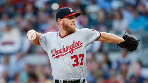 Washington Nationals starting pitcher Stephen Strasburg works against the Atlanta Braves during the first inning of a baseball game Thursday, April 20, 2017, in Atlanta. (AP Photo/John Bazemore)