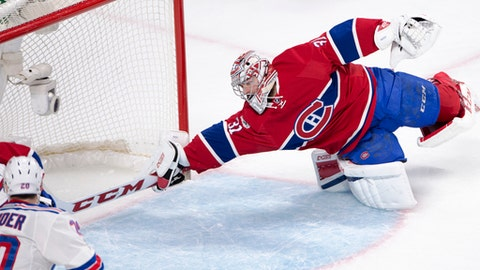 Montreal Canadiens goalie Carey Price dives to make a save against the New York Rangers during the second period of Game 5 of a first-round NHL hockey Stanley Cup playoff series, Thursday, April 20, 2017, in Montreal. (Ryan Remiorz/The Canadian Press via AP)