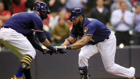 Milwaukee Brewers' Eric Thames, right, is congratulated by Jonathan Villar, left, after hitting a two-run home run against the St. Louis Cardinals during the fifth inning of a baseball game Thursday, April 20, 2017, in Milwaukee. (AP Photo/Darren Hauck)