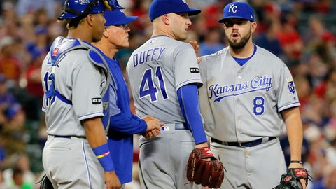 Kansas City Royals' Salvador Perez (13), manager Ned Yost, second from left, and Mike Moustakas (8) congratulate Danny Duffy (41) as he leaves the mound in the eighth inning of the team's baseball game against the Texas Rangers in Arlington, Texas, Thursday, April 20, 2017. (AP Photo/Tony Gutierrez)