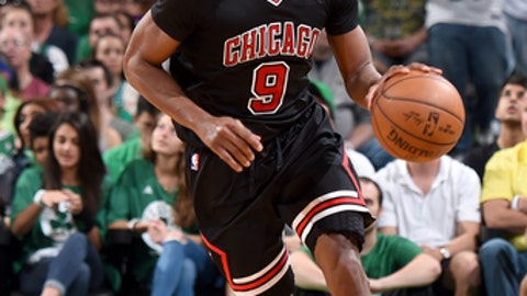 BOSTON, MA - APRIL 16:  Rajon Rondo #9 of the Chicago Bulls handles the ball against the Boston Celtics during the Eastern Conference Quarter-finals of the 2017 NBA Playoffs on April 16, 2017 at TD Garden in Boston, MA. NOTE TO USER: User expressly acknowledges and agrees that, by downloading and or using this Photograph, user is consenting to the terms and conditions of the Getty Images License Agreement. Mandatory Copyright Notice: Copyright 2017 NBAE (Photo by Brian Babineau/NBAE via Getty Images)