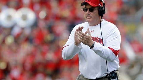 FILE - In this Sept. 10, 2016, file photo, Wisconsin head coach Paul Chryst claps from the sideline during an NCAA college football game against Akron in Madison, Wis. Running back Chris James and cornerback Nick Nelson are the latest transfers in position to make impacts at Wisconsin. (AP Photo/Aaron Gash, File)
