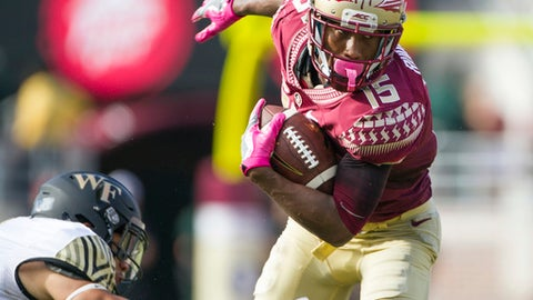 FILE - In this Oct. 15, 2016, file photo, Florida State wide receiver Travis Rudolph (15) sheds Wake Forest defender Jesse Bates III in the first half of an NCAA college football game in Tallahassee, Fla. Former college receivers Malachi Dupre of LSU and Travis Rudolph of Florida State are examples of pro prospects who left high school as elite national recruits and now enter the NFL draft trying to overcome a perceived lack of production in college.  (AP Photo/Mark Wallheiser, File)