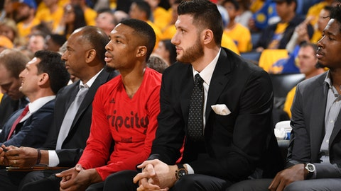 OAKLAND, CA - APRIL 16:  Jusuf Nurkic #27 and Damian Lillard #0 of the Portland Trail Blazers sit on the bench before the Western Conference Quarterfinals game against the Golden State Warriors during the 2017 NBA Playoffs on April 16, 2017 at Oracle Arena in Oakland, California. NOTE TO USER: User expressly acknowledges and agrees that, by downloading and or using this photograph, user is consenting to the terms and conditions of Getty Images License Agreement. Mandatory Copyright Notice: Copyright 2017 NBAE (Photo by Garrett Ellwood/NBAE via Getty Images)