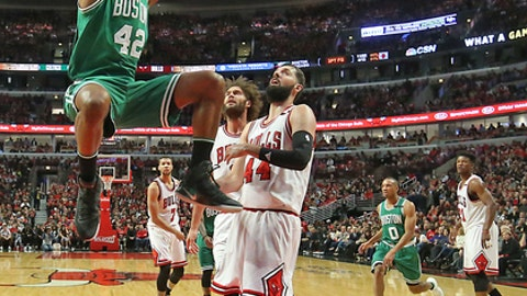 CHICAGO - APRIL 21: Boston Celtics' Al Horford slam dunks as Chicago Bulls' Robin Lopez and Nikola Mirotic watch during the second half. The Boston Celtics visit the Chicago Bulls for Game Three of the first round of the NBA Playoffs at the United Center in Chicago, IL on Apr. 21, 2017. (Photo by Matthew J. Lee/The Boston Globe via Getty Images)