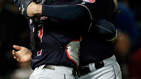Cleveland Indians starting pitcher Corey Kluber, right, celebrates with catcher Yan Gomes after they defeated the Chicago White Sox in a baseball game Friday, April 21, 2017, in Chicago. (AP Photo/Nam Y. Huh)