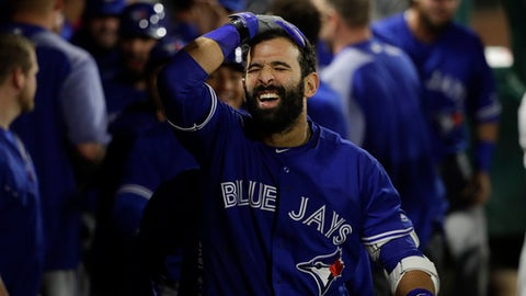 Toronto Blue Jays' Jose Bautista celebrates his three-run home run in the dugout during the 13th inning of a baseball game against the Los Angeles Angels, Saturday, April 22, 2017, in Anaheim, Calif. (AP Photo/Jae C. Hong)