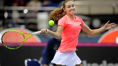 Aliaksandra Sasnovich, of Belarus, returns a ball to Viktorija Golubic, of Switzerland, during the Fed Cup World Group semi final tennis match between Belarus and Switzerland, in Minsk, Belarus, Saturday, April 22, 2017. (AP Photo/Sergei Grits)