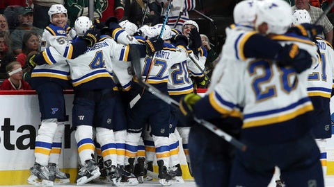 St. Louis Blues celebrate a 4-3 overtime win over the Minnesota Wild in Game 3 of an NHL hockey first-round Stanley Cup playoff series, Saturday, April 22, 2017, in St. Paul, Minn. (Anthony Souffle/Star Tribune via AP)
