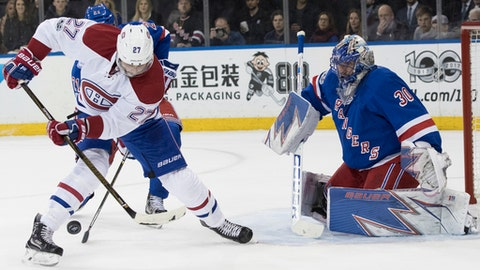 New York Rangers goalie Henrik Lundqvist (30) tends the net against Montreal Canadiens center Alex Galchenyuk (27) during the first period of Game 6 of a first-round NHL hockey Stanley Cup playoff series, Saturday, April 22, 2017, at Madison Square Garden in New York. (AP Photo/Mary Altaffer)