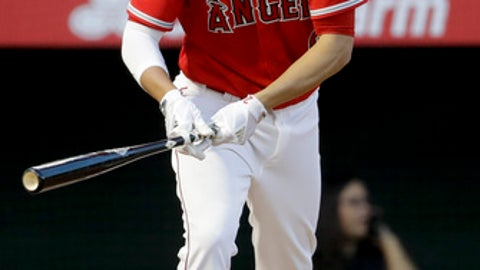 Los Angeles Angels' Andrelton Simmons watches his grand slam during the third inning of a baseball game against the Toronto Blue Jays in Anaheim, Calif., Saturday, April 22, 2017. (AP Photo/Chris Carlson)