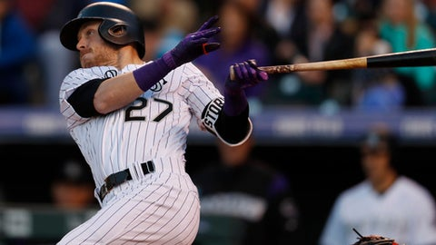 Colorado Rockies' Trevor Story follows the flight of his solo home run off San Francisco Giants starting pitcher Matt Moore to lead off the bottom of the fourth inning of a baseball game Saturday, April 22, 2017, in Denver. (AP Photo/David Zalubowski)