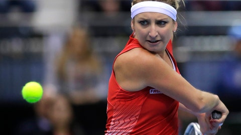 Timea Bacsinszky of Switzerland, returns a ball to Aliaksandra Sasnovich of Belarus, during the Fed Cup World Group semi final tennis match between Belarus and Switzerland, in Minsk, Belarus, Sunday, April 23, 2017. (AP Photo/Sergei Grits)