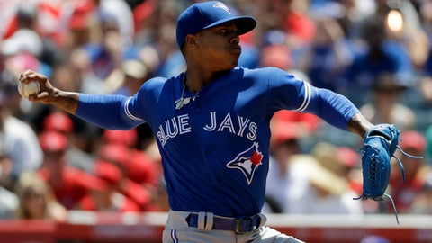 Toronto Blue Jays starting pitcher Marcus Stroman throws against the Los Angeles Angels during the first inning of a baseball game in Anaheim, Calif., Sunday, April 23, 2017. (AP Photo/Chris Carlson)
