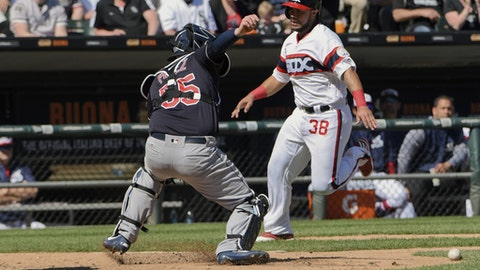 Chicago White Sox's Omar Narvaez (38) scores past Cleveland Indians catcher Roberto Perez (55) during the sixth inning of a baseball game in Chicago on Sunday, April 23, 2017. (AP Photo/Matt Marton)