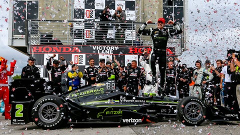 Josef Newgarden celebrates after winning the Indy Grand Prix of Alabama auto race, Sunday, April 23, 2017, in Birmingham, Ala. (AP Photo/Butch Dill)