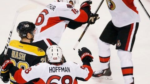 Ottawa Senators' Clarke MacArthur (16) celebrates his goal with teammate Bobby Ryan (9) as Boston Bruins' Riley Nash (20) looks on during overtime in game six of a first-round NHL hockey Stanley Cup playoff series, Sunday, April 23, 2017, in Boston. The Senators won 3-2. (AP Photo/Michael Dwyer)
