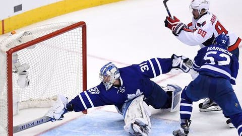 Washington Capitals center Marcus Johansson (90) scores against Toronto Maple Leafs goalie Frederik Andersen (31) as defenseman Martin Marincin (52) defends during overtime of Game 6 of an NHL hockey Stanley Cup first-round playoff series in Toronto on Sunday, April 23, 2017. The Washington Capitals beat the Maple Leafs 2-1 on Sunday to capture the best-of-seven Eastern Conference quarter-final series in six games. (Frank Gunn/The Canadian Press via AP)