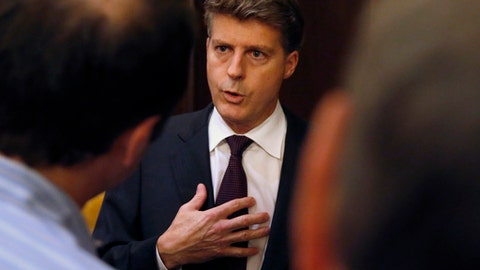 FILE- In this Nov. 16, 2016, file photo, Hal Steinbrenner, owner of the New York Yankees, talks with reporters during the baseball owners meetings at the Drake Hotel in Chicago. The Los Angeles Dodgers and the Yankees are cutting payroll and their luxury tax bills, just as Bryce Harper, Manny Machado and perhaps Clayton Kershaw near the free-agent market after the 2018 season. (AP Photo/Charles Rex Arbogast, File)