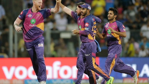Rising Pune Supergiant players celebrate the wicket of Mumbai Indian batsman Nitish Rana during their Indian Premier League (IPL) cricket match in Mumbai, India, Monday, April 24, 2017.(AP Photo/Rafiq Maqbool)
