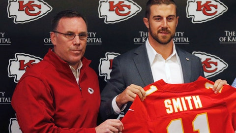FILE - In this March 13, 2013, file photo, Kansas City Chiefs general manager John Dorsey, left, stands with newly signed quarterback Alex Smith following a news conference at the NFL football team's practice facility in Kansas City, Mo. Smith is firmly entrenched as the starter in Kansas City and Dorsey is firmly in his corner. (AP Photo/Orlin Wagner, File)