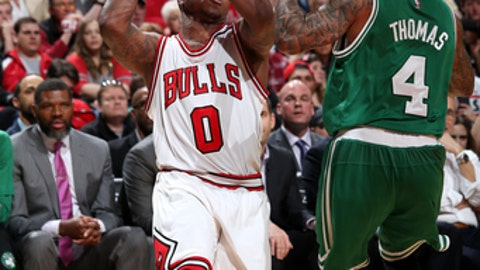 CHICAGO, IL - APRIL 23: Isaiah Canaan #0 of the Chicago Bulls drives to the basket during the game against the Boston Celtics in Game Four during the Eastern Quarterfinals of the 2017 NBA Playoffs on April 23, 2017 at the United Center in Chicago, Illinois. NOTE TO USER: User expressly acknowledges and agrees that, by downloading and or using this Photograph, user is consenting to the terms and conditions of the Getty Images License Agreement. Mandatory Copyright Notice: Copyright 2017 NBAE (Photo by Gary Dineen/NBAE via Getty Images)