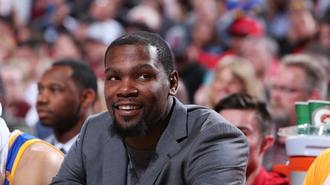 PORTLAND, OR - APRIL 22:  Kevin Durant #35 of the Golden State Warriors smiles from the bench in Game Three of the Western Conference Quarterfinals against the Portland Trail Blazers of the 2017 NBA Playoffs on April 22, 2017 at the Moda Center in Portland, Oregon. NOTE TO USER: User expressly acknowledges and agrees that, by downloading and or using this Photograph, user is consenting to the terms and conditions of the Getty Images License Agreement. Mandatory Copyright Notice: Copyright 2017 NBAE (Photo by Sam Forencich/NBAE via Getty Images)