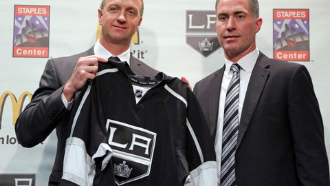 John Stevens, right, and Los Angeles Kings Vice President and General Manager Rob Blake pose during Stevens' introduction as the Kings new head coach at a news conference at the NHL hockey club's home at Staples Center in Los Angeles, Monday, April 24, 2017. Stevens has most recently served as the club's Associate Head Coach. He has been part of the Kings coaching staff the past seven seasons. (AP Photo/Reed Saxon)