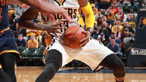 INDIANAPOLIS, IN - APRIL 23: Paul George #13 of the Indiana Pacers handles the ball against the Cleveland Cavaliers during Game Four of the Eastern Conference Quarterfinals of the 2017 NBA Playoffs on April 23, 2017 at Bankers Life Fieldhouse in Indianapolis, Indiana. NOTE TO USER: User expressly acknowledges and agrees that, by downloading and or using this photograph, User is consenting to the terms and conditions of the Getty Images License Agreement. Mandatory Copyright Notice: Copyright 2017 NBAE (Photo by Jeff Haynes/NBAE via Getty Images)