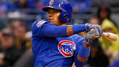 Chicago Cubs' Addison Russell drives in a run with a single off Pittsburgh Pirates starting pitcher Chad Kuhl in the first inning of a baseball game in Pittsburgh, Monday, April 24, 2017. (AP Photo/Gene J. Puskar)