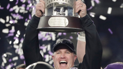 Northwestern head coach Pat Fitzgerald, left, holds up the trophy while celebrating with his players after Northwestern beat Pittsburgh 31-24 in the Pinstripe Bowl NCAA college football game, Wednesday, Dec. 28, 2016, in New York. (AP Photo/Julie Jacobson)