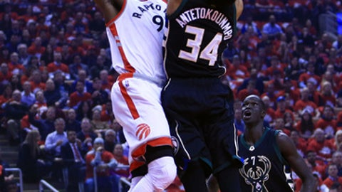 TORONTO, ON - APRIL 24:  Serge Ibaka #9 of the Toronto Raptors dunks the ball as Giannis Antetokounmpo #34 of the Milwaukee Bucks defends in the first half of Game Five of the Eastern Conference Quarterfinals during the 2017 NBA Playoffs at Air Canada Centre on April 24, 2017 in Toronto, Canada.  NOTE TO USER: User expressly acknowledges and agrees that, by downloading and or using this photograph, User is consenting to the terms and conditions of the Getty Images License Agreement.  (Photo by Vaughn Ridley/Getty Images)