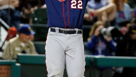 Minnesota Twins' Miguel Sano raises the bat over his head after striking out against pitching from Texas Rangers' Jose Leclerc in the eighth inning of a baseball game in Arlington, Texas, Monday April 24, 2017. (AP Photo/Tony Gutierrez)