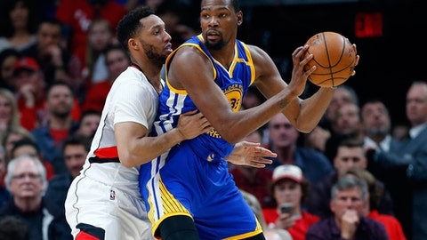 PORTLAND, OR - APRIL 24:  Kevin Durant #35 of the Golden State Warriors is guarded by by Maurice Harkless #4 of the Portland Trail Blazers during Game Four of the Western Conference Quarterfinals of  the 2017 NBA Playoffs at Moda Center on April 24, 2017 in Portland, Oregon.  NOTE TO USER: User expressly acknowledges and agrees that, by downloading and or using this photograph, User is consenting to the terms and conditions of the Getty Images License Agreement.  (Photo by Jonathan Ferrey/Getty Images)