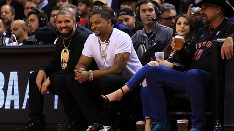 TORONTO, ON - NOVEMBER 16:  Drake smiles during the second half of an NBA game between the Golden State Warriors and the Toronto Raptors at Air Canada Centre on November 16, 2016 in Toronto, Canada.  NOTE TO USER: User expressly acknowledges and agrees that, by downloading and or using this photograph, User is consenting to the terms and conditions of the Getty Images License Agreement.  (Photo by Vaughn Ridley/Getty Images)