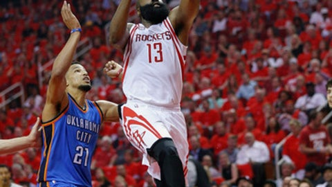 HOUSTON, TX - APRIL 25:  James Harden #13 of the Houston Rockets drives past Andre Roberson #21 of the Oklahoma City Thunder for a layup during Game Five of the Western Conference Quarterfinals game of the 2017 NBA Playoffs at Toyota Center on April 25, 2017 in Houston, Texas. NOTE TO USER: User expressly acknowledges and agrees that, by downloading and/or using this photograph, user is consenting to the terms and conditions of the Getty Images License Agreement.  (Photo by Bob Levey/Getty Images)