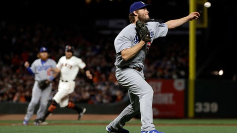 Los Angeles Dodgers starting pitcher Clayton Kershaw throws to first base for the out on a grounder by San Francisco Giants' Brandon Crawford during the third inning of a baseball game Tuesday, April 25, 2017, in San Francisco. (AP Photo/Marcio Jose Sanchez)