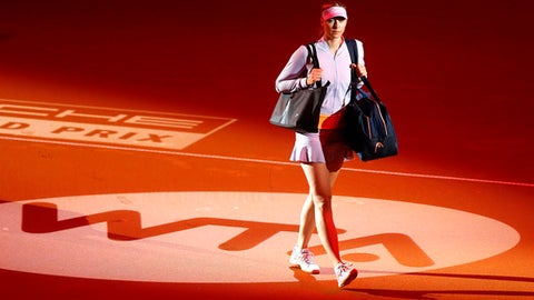 Russia's Maria Sharapova enters the court for her match against Italy's Roberta Vinci at the Porsche Grand Prix in Stuttgart, Germany, Wednesday, April 26, 2017. It is Sharapova's first match after a 15 months lasting doping ban. (AP Photo/Michael Probst)