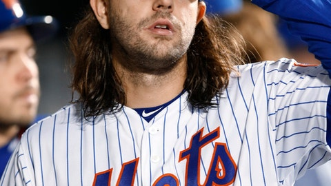 New York Mets starting pitcher Robert Gsellman leaves after being pulled by manager Terry Collins during the fifth inning of the baseball game against the Atlanta Braves, Wednesday, April 26, 2017, in New York. (AP Photo/Kathy Willens)