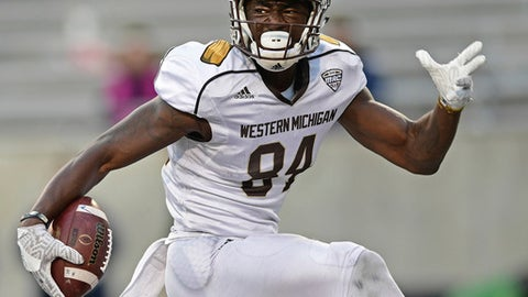 FILE - In this Oct. 15, 2016, file photo, Western Michigan receiver Corey Davis celebrates scoring a touchdown during the team's NCAA college football game against Akron in Akron, Ohio. Davis headlines a group of receivers from smaller schools who are hoping for additional success at the next level. Players like Davis can put up huge numbers in college, but since they've faced weaker competition, it's hard for NFL teams to evaluate them. (AP Photo/David Dermer, File)