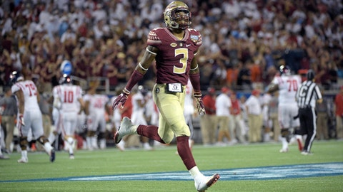 FILE - In this Sept. 6, 2016, file photo, Florida State defensive back Derwin James (3) celebrates after an interception by defensive back Tarvarus McFadden during the second half of an NCAA college football game against Mississippi in Orlando, Fla. James is one of the players to keep an eye on when ACC schools begin preseason camp over the summer. (AP Photo/Phelan M. Ebenhack, File)