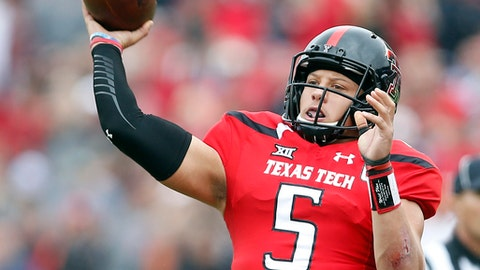 FILE - This Nov. 5, 2016, file photo shows Texas Tech's Patrick Mahomes passing the ball during an NCAA college football game in Lubbock, Texas. The NFL Draft will be held April 27-29, 2017, in Philadelphia. (Brad Tollefson/Lubbock Avalanche-Journal via AP, File)