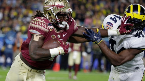 FILE - This Dec. 30, 2016, file photo shows Michigan safety Delano Hill, right, attempting to stop Florida State running back Dalvin Cook, left, during the first half of the Orange Bowl NCAA college football game in Miami Gardens, Fla. The NFL Draft will be held April 27-29, 2017, in Philadelphia.(AP Photo/Lynne Sladky, File)