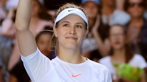 Canada's Eugenie Bouchard waves after defeating China's Peng Shuai in their second round match at the Australian Open tennis championships in Melbourne, Australia, Wednesday, Jan. 18, 2017. (AP Photo/Aaron Favila)