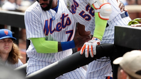 New York Mets' Jose Reyes (7) helps teammate Yoenis Cespedes (52) down the stairs into the dugout after Cespedes was injured during the fourth inning of a baseball game against the Atlanta Braves, Thursday, April 27, 2017, in New York. (AP Photo/Frank Franklin II)