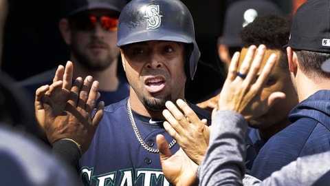 Seattle Mariners' Nelson Cruz is congratulated after scoring during the sixth inning of a baseball game against the Detroit Tigers, Thursday, April 27,2017, in Detroit. (AP Photo/Carlos Osorio)