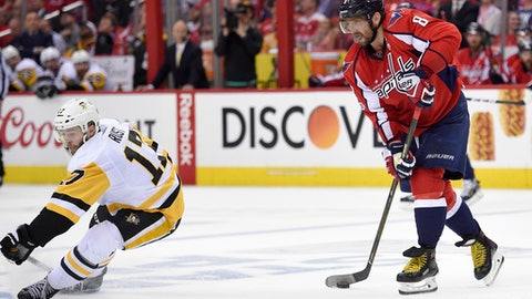 Washington Capitals left wing Alex Ovechkin (8), of Russia, skates with the puck against Pittsburgh Penguins right wing Bryan Rust (17) during the second period of Game 1 in an NHL hockey Stanley Cup second-round playoff series, Thursday, April 27, 2017, in Washington. (AP Photo/Nick Wass)